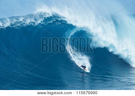 MAUI, HI - JANUARY 16 2016: Professional surfer Joao Marco Maffini rides a giant wave at the legendary big wave surf break known as