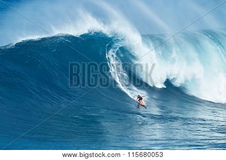 MAUI, HI - JANUARY 16 2016: Professional surfer Tyler Larronde rides a giant wave at the legendary big wave surf break known as
