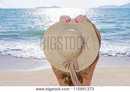 woman enjoying beach relaxing joyful in summer by tropical blue water.