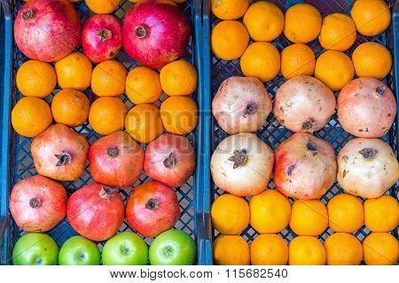 Oranges, apples and pomegranates