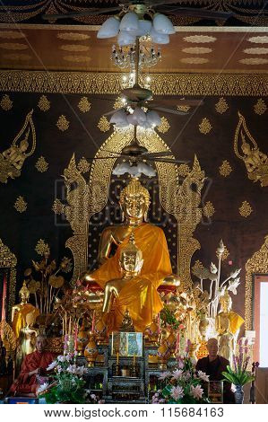 Sitting Golden Buddha On Wat Jhet Yot In Thailand.