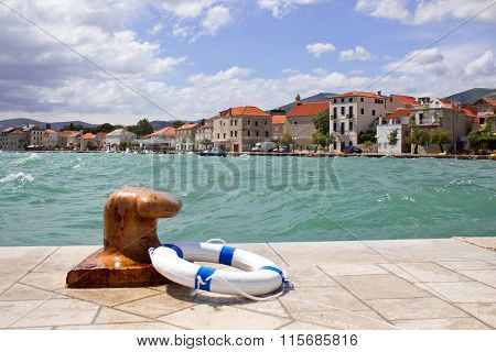 Croatian Costal Town, Windy Sea, Bollard And Life Buoy