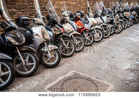 Row of the motorcycles on the old street