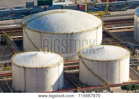 Three white storage tanks