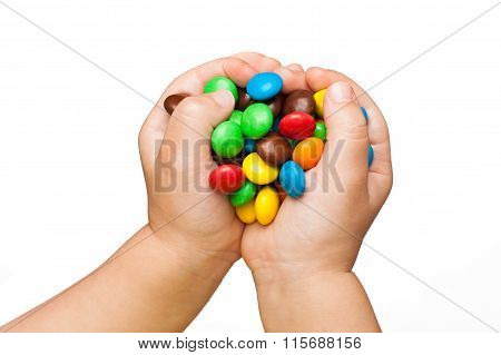 children's hands with candy