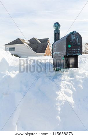 Deep Drifts Bury Mailbox Of Modern Home