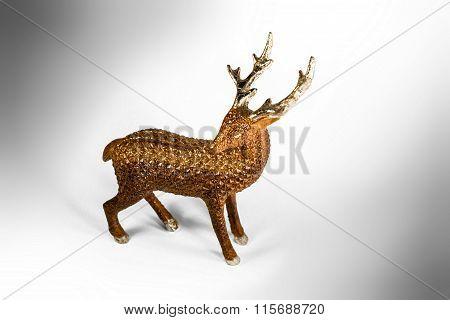 Deer Coveered In Glitter With Golden Horns