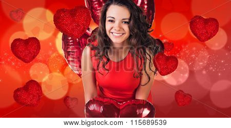 Woman in red dress stands on bokeh background