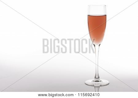 glass of rose wine on a white background