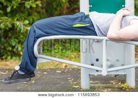 Active Man Exercising On Bench Outdoor.