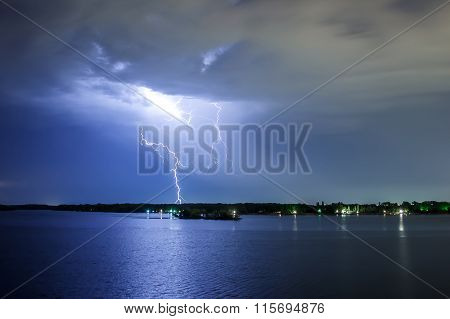 Lightning Thunderbolt Reflected In The Water At Night