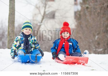 Two Kids, Boy Brothers, Sliding With Bob In The Snow, Wintertime
