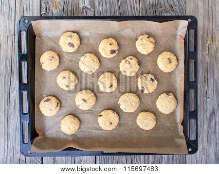 Uncooked Oatmeal Cookies On Baking Paper