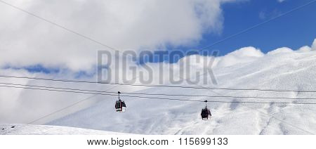 Panoramic View On Gondola Lifts And Off-piste Slope At Sun Day