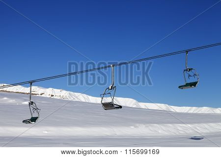 Chair-lift And Blue Sky At Sun Day