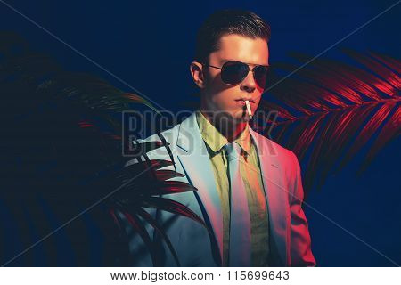 Handsome Guy In Formal Attire Smoking A Cigarette