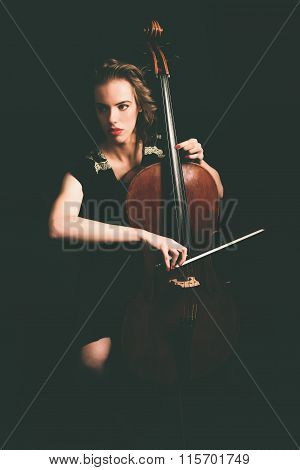 Pretty Young Woman Playing The Cello