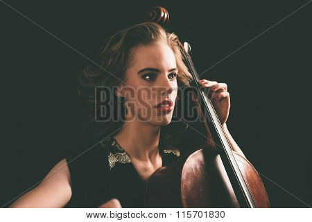 Young Aspiring Musician Playing A Cello