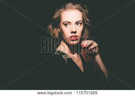 Pensive Female Cellist Holding A Cello Instrument