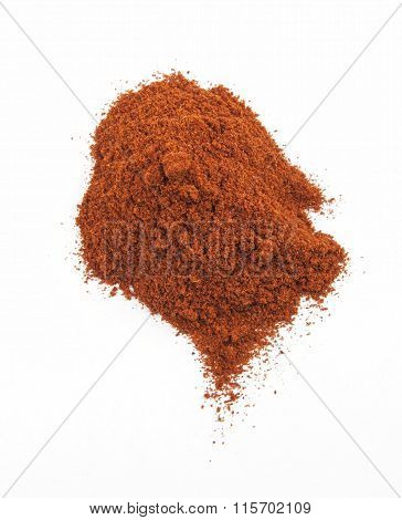 pile of red paprika powder solated on white