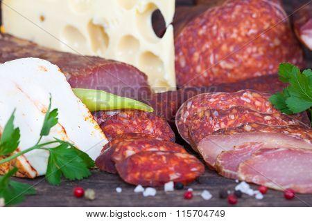 Sausage, salami and ham with edamer cheese and smoked cheese