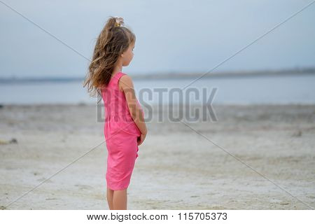 Little Girl Looks At The Sea