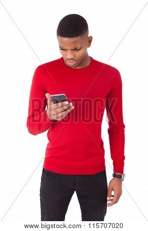 African American Young Man Sending A Text Message On his Smartphone - Black Teenager People