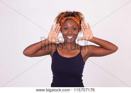 Beautiful Smiling African American Woman Making Frame Gesture With Her Hands