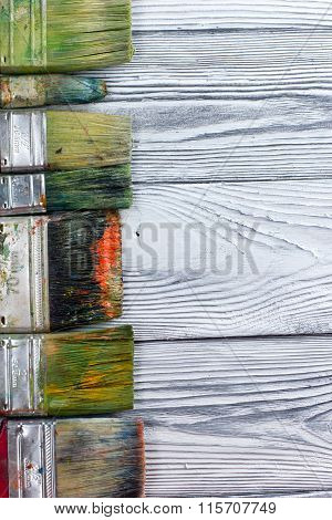 Artistic, artist, art. Used artist paintbrushes mastehin on wood background.