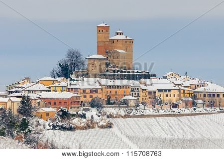 Small medieval town on snowy hill in Piedmont, Northern Italy.