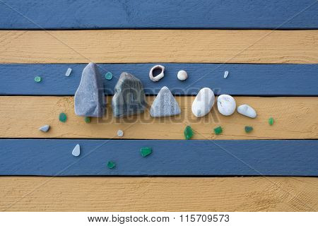 The Composition Of Sea Stones, Glass And Shells