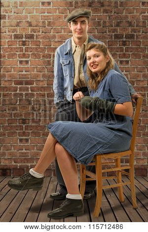 Young Worker Couples In Vintage Clothing In Their Home