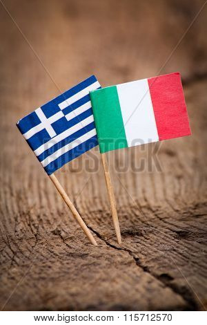 Flags of Italy and Greece on wooden background