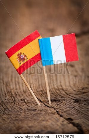 Flags of Spain and France on wooden background