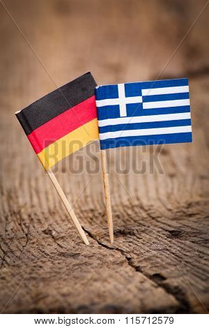 Flags of Germany and Greece on wooden background