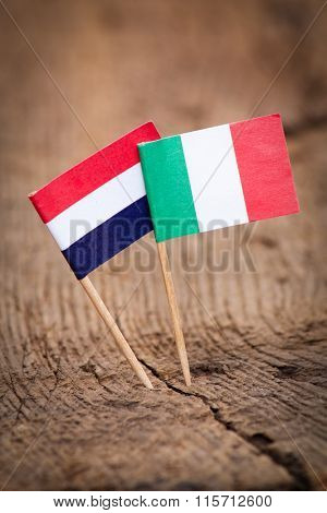 Flags of Netherlands and Italy on wooden background