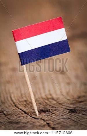 Stylized flag of Netherlands on wooden background