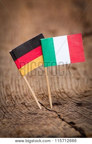 Flags of Italy and Germany on wooden background