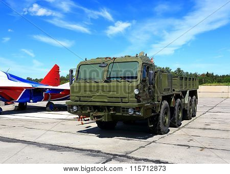 MOSCOW REGION  -   JUNE 13:Airfield wheeled drawing vehicle for towing aircraft and other aviation equipment   on June 13, 2015 in Moscow region