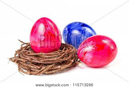Easter background with colored eggs and nest