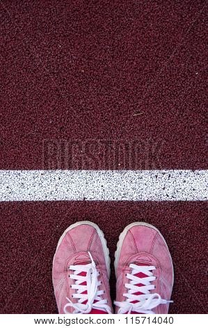 Top view of shoes on running track