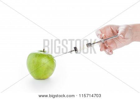 Wrinkled Green Apple And Syringe In Female Hand On White Background