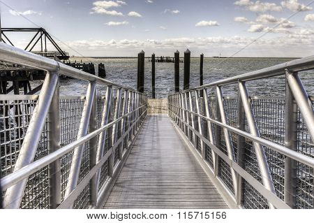 Symmetrical Metal Walkway To Water