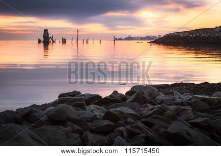 Rocky Shore And Purple Sunset