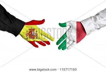 Spain and Italy leaders shaking hands on a deal agreement