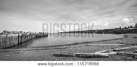 People fishing at the end of a dock in Springtime. Nova Scotia coastline in June.