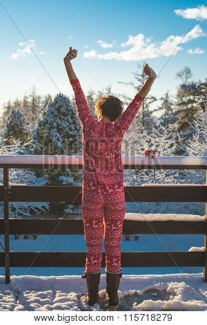 Young woman wake up happy outdoor on the balcony, freedom concept, breathing fresh air