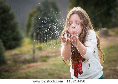 Girl Blowing Glitter