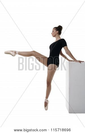 Graceful ballerina rehearses, isolated on white