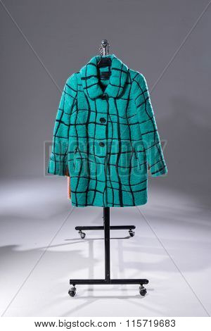 Set of female coat clothes on hangers